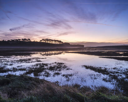 Winter twilight clouds and perfect reflections on the River Otter at Budleigh Salterton, Devon, England, United Kingdom, Europe - RHPLF06366