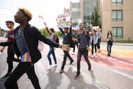 Group of students with banners on gay pride march - HEROF38487