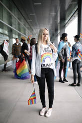 Portrait of student on gay pride rally with rainbow flag - HEROF38490