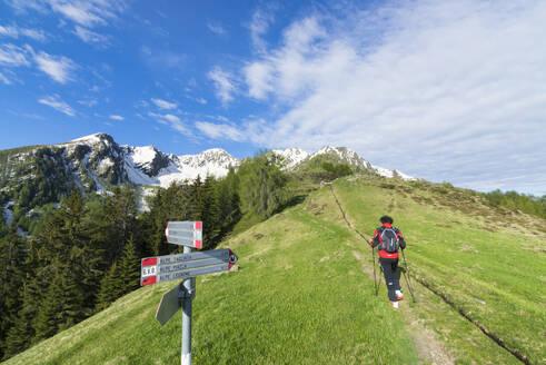 Hiker on footpath, Motta di Olano, Valgerola, Valtellina, Sondrio province, Lombardy, Italy, Europe - RHPLF06953