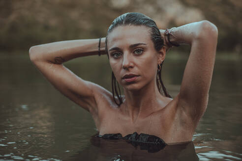 Portrait of young blond woman bathing in a lake - ACPF00627