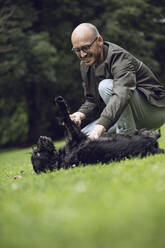 Man and his dog in a park - MCF00270