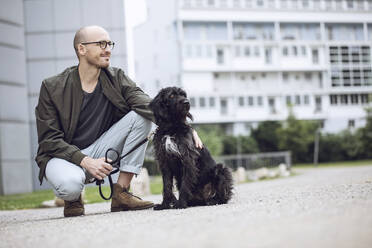 Man and his dog in the city - MCF00276
