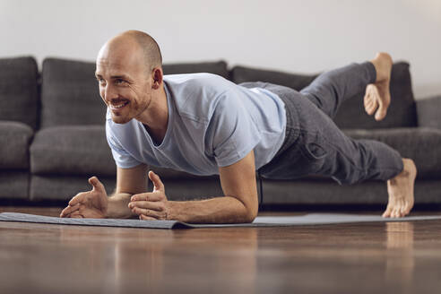 Man doing gymnastics at home - MCF00306