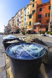Fishing nets with typical houses in the background, Porto Venere, Cinque Terre, UNESCO World Heritage Site, Liguria, Italy, Europe - RHPLF07190