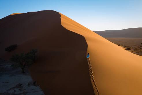 Drone shot of model Climbing Dune 13, Sossusvlei, Namibia, Africa - RHPLF07379