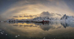 Panoramic winter landscape with snowcapped mountains and snow covered village of Hamnoy, Lofoten Islands, Arctic, Norway, Europe - RHPLF07394