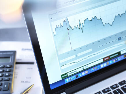 Share price data from a investors portfolio on a laptop computer screen - ABR00480