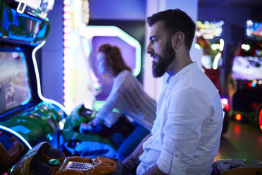 Man at a driving simulator in an amusement arcade - ZEDF02582