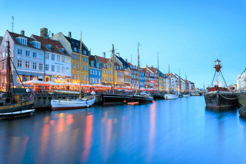 Night view of the illuminated harbour and canal of the entertainment district of Nyhavn, Copenhagen, Denmark, Europe - RHPLF07491