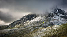 A yellow cable car in the Jungfrau below the summit of Tschuggen shrouded in snow and mist, Valais, Switzerland, Europe - RHPLF07581