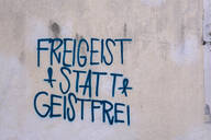 Freigeist statt Geistfrei text written with graffiti on wall - LB02685