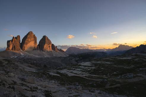Scenic view of Tre Cime Di Lavaredo against sky at sunset, Italy - LOMF00893