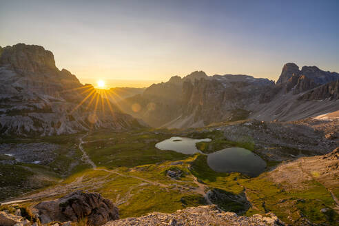 Scenic view of Piani lakes and Tre Cime Di Lavaredo against sky at sunrise, Italy - LOMF00899