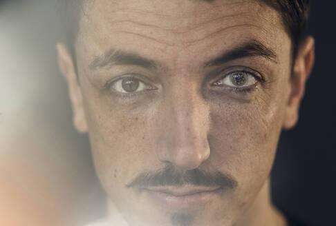 Portrait of brunette man with lens, cyborg - KSHSF00001