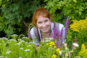 Portrait of redheaded teenage girl in garden - LBF02692