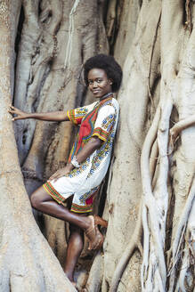 Young woman posing in a tree trunk - DLTSF00013
