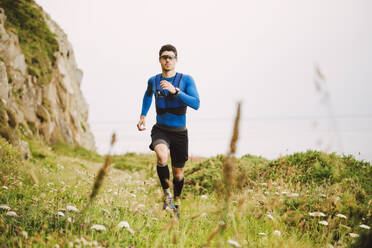 Trail runner training in nature, Ferrol, Spain - RAEF02294