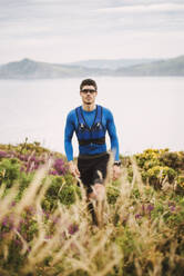 Portrait of trail runner in the mountains, Ferrol, Spain - RAEF02300