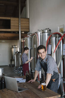 Smiling young entrepreneur working at a brewery - ALBF01066