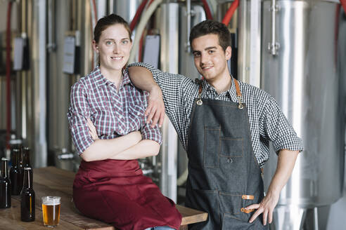 Portrait of confident young entrepreneurs at a brewery - ALBF01099