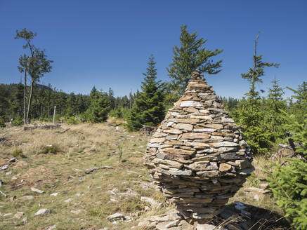 Stone made sculpture on land against clear blue sky in Bavarian Forest, Germany - HUSF00076