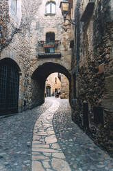 Cobbled street of the medieval town of Pals, Catalonia, Spain - GEMF03130