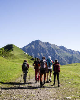 Group of hikers walking in the mountains, Orobie Mountains, Lecco, Italy - MCVF00001