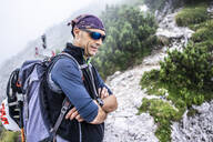 Portrait of a hiker in the mountains, Orobie Mountains, Lecco, Italy - MCVF00004