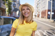 Portrait of happy young woman in the city - BSZF01357