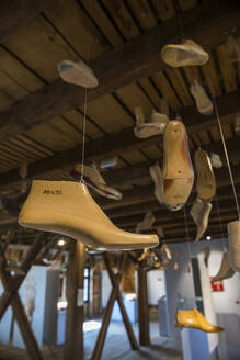 Shoes hanging from ceiling in Fagus Factory, Lower Saxony, Germany - RUN02898