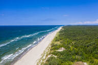 Aerial view of sea against blue sky during sunny day in Curonian Spit, Russia - RUNF02907