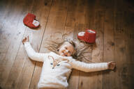 Happy girl lying on the floor and waiting for Christmas - IPF00526