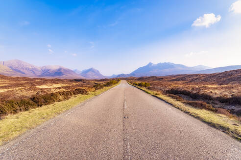 UK, Scotland, Highlands, Isle of Skye, A863 road with Cuillin mountains in the distance. - SMAF01483