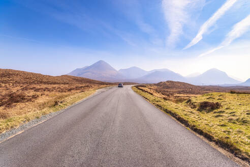 UK, Scotland, Highlands, Isle of Skye, A863 road with Cuillin mountains in the distance. - SMAF01510