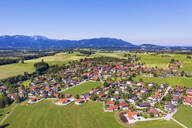 Aerial view of Greiling against clear sky with Benediktenwand and Blomberg mountains in background, Tölzer Land, Upper Bavaria, Bavaria, Germany - SIEF08974