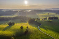 Aerial view of landscape during sunrise at Peretshofen near Dietramszell, Tölzer Land, Upper Bavaria, Bavaria, Germany - SIEF08983