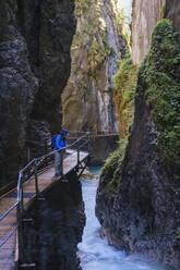 Senior woman at Wasserfallsteig in Leutasch Gorge, Tyrol, Austria - SIEF09004
