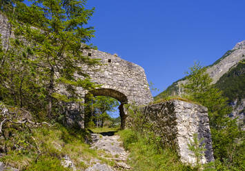Gate in defensive wall of Porta Claudia against clear blue sky at Scharnitz, Tyrol, Austria - SIEF09010
