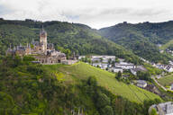 Aerial view of castle on mountain against cloudy sky in town, Cochem, Germany - RUNF02915