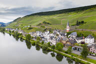 Aerial view of Zell town by Mosel River against sky, Germany - RUNF02921