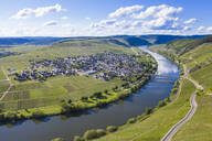 Drone shot of Mosel River amidst land, Trittenheim, Germany - RUNF02927