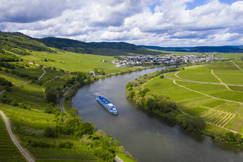 Drone shot of cruise ship on Mosel River amidst land against cloudy sky, Germany - RUNF02930