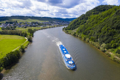 Drone shot of passenger ship on Mosel River against cloudy sky, Germany - RUNF02933