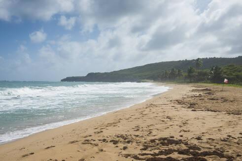 Scenic view of Bathway Beach against cloudy sky at Grenada, Caribbean - RUNF02968