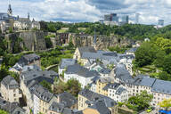 High angle view of old town in Luxembourg against cloudy sky - RUNF03045
