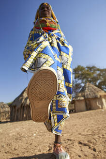 Muhila woman about to step on the camera, Kehamba, Chibia, Angola - VEGF00634