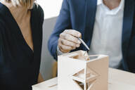 Architect explaining model to customer - KNSF06336