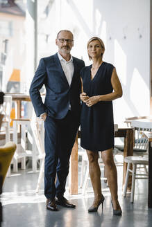 Portrait of confident businessman and woman - KNSF06348