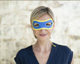 Portrait of blond businesswoman, wearing superwoman mask - KNSF06360